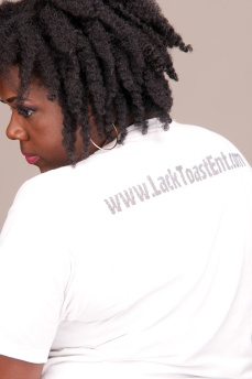 the back of the white t-shirt boast the website (at an additional charge)